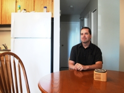 Tom McKenna sits in the kitchen of his affordable home, a luxury not available to everyone in Prince Albert and one he is thankful for.